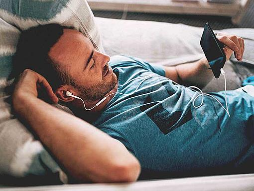 What makes men low on energy?-4508-male_laying_couch_earbuds_looking_phone-732x549-thumbnail.jpg