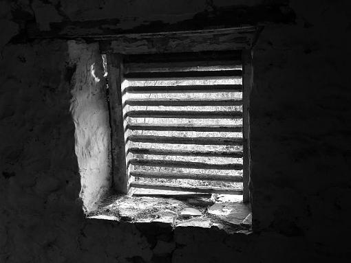 Weathered, Battered and Neglected-springhouse-window-b-w.jpg